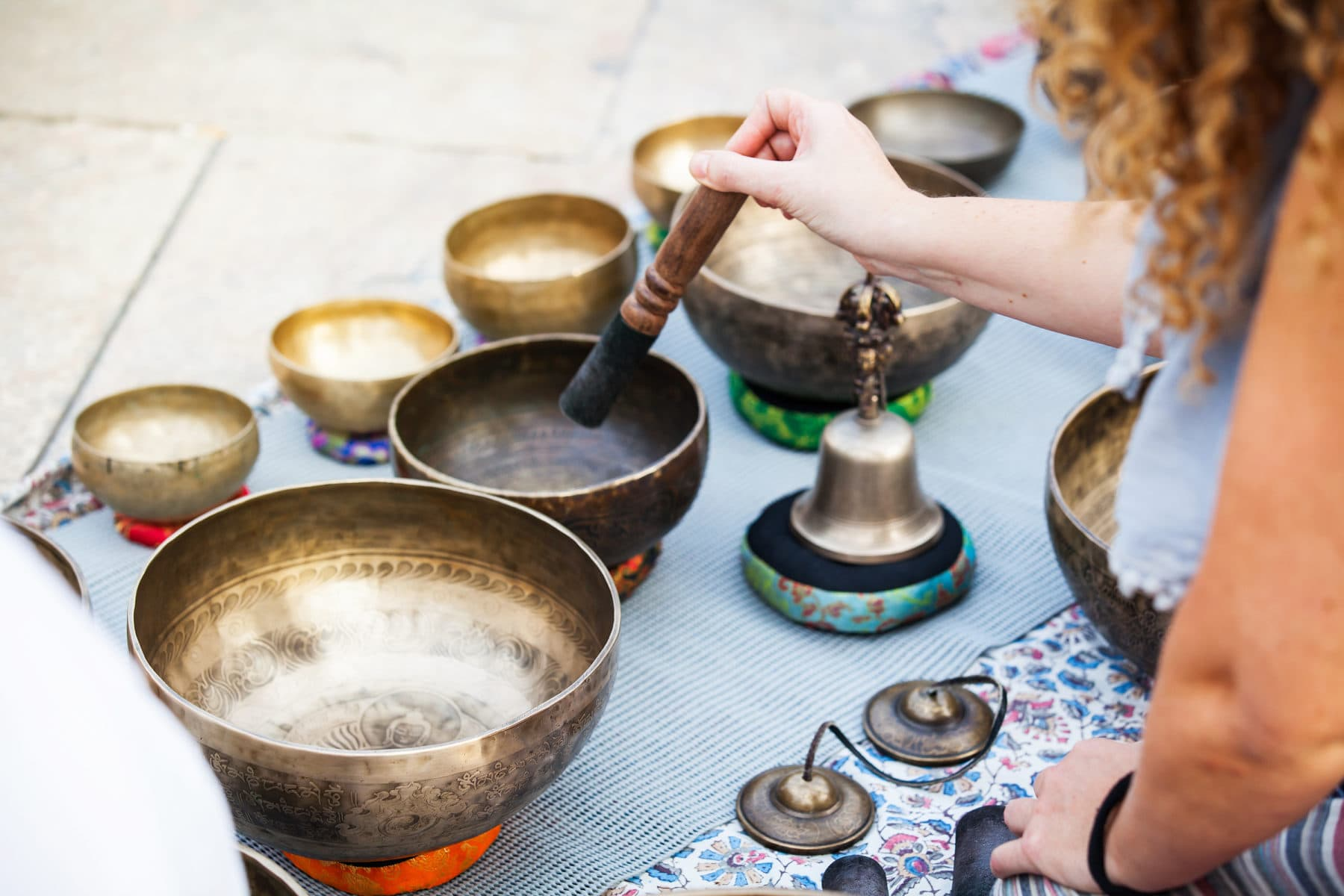 Hand playing tibetan bowls